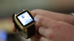 Man demonstrates the capabilities of smart watch. Stock Footage