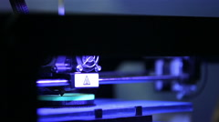 Printing plastic model on a 3D printer in process. Stock Footage