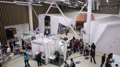 A lot of people in the large exhibition hall at the festival of new technologies Stock Footage