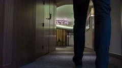Businessman walking around the hotel hall Stock Footage