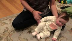 Baby Trying to Sit, But Fails Stock Footage