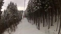 Sitting down on the ski lift in Bukovel, Ukraine Stock Footage