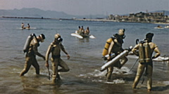 French Riviera 1956: divers walking to the beach - stock footage