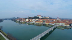 AERIAL 4K: Old town Ptuj next to river with bridge over Stock Footage