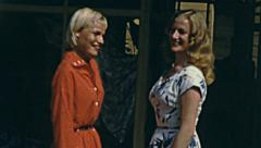 French Riviera 1956: models posing for a picture - stock footage