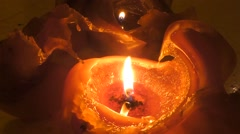 Two orange candle burning - seamless looping Stock Footage