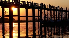 Famous U Bein bridge in Amarapura, near Mandalay in Myanmar (Burma) at sunset - stock footage