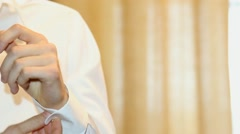 Man dressing up white shirt. hands of man. close up. Stock Footage