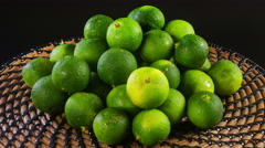 Close up rotation heap of small green limes - stock footage