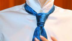 Putting tie. man in white shirt and blue tie Stock Footage