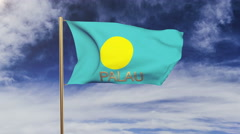 Palau flag with title waving in the wind. Looping sun rises style.  Animation Stock Footage