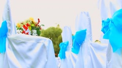 Rows of decorated white wooden chairs waiting for guests. dolly camera movement Stock Footage