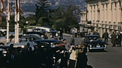 Monaco 1956: crowd in front of the Casino the day of the royal wedding - stock footage