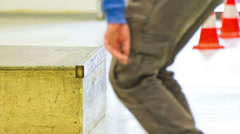 Jumping on wooden box with skate close up Stock Footage