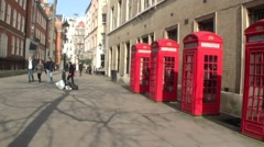 Establishing pan of a row of Red Telephone Boxes in London in the United Kingdom Stock Footage