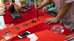Artist writes characters in Chinatown, Singapore Stock Footage