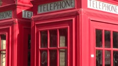 Close up tilt of a Red Telephone Box in London in the United Kingdom Stock Footage