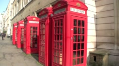 Mid shot of five Red Telephone Boxes in London in the United Kingdom Stock Footage