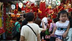 Festive trade on the eve of Chinese New Year in Chinatown in Singapore - stock footage