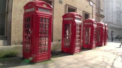 Wide shot of five London Red Telephone Boxes in London in the United kingdom Stock Footage