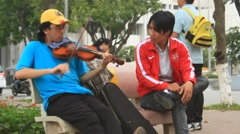 Man playing violin on the streets Stock Footage