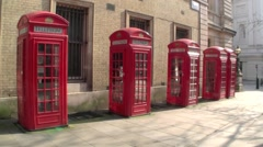 Wide shot of five London Red Telephone Boxes in London United kingdom Stock Footage