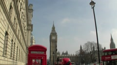 Tilt of a Red London Telephone Box with Big Ben Clock Tower in London UK Stock Footage