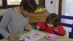 Home Fun With Happy Mom And Daughter Playing And Painting - stock footage