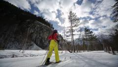 Woman cross-country skiing Stock Footage
