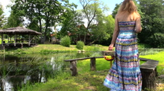Healthy pregnancy. Happy pregnant lady relaxing in park Stock Footage