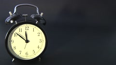 Alarm clock on black background Stock Footage