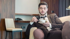 Young handsome man drinking coffee Stock Footage