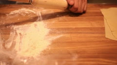 Male chef hands preparing dough with rolling pin for asian food on wooden board Stock Footage