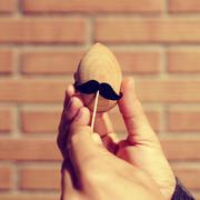 moustached wooden egg, with a filter effect - stock photo