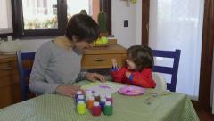 Mother And Daughter Having Fun With Paint At Home - stock footage