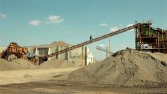 Construction worker in control, walking up on conveyor belt for separation sand. Stock Footage