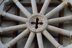 Close up photo of a wheel on the church - stock photo