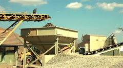Sand falling from conveyor belt on pile, separation of sand, blue sky, sunny day Stock Footage