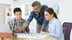 Teacher with students in architecture school Stock Footage