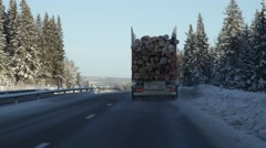 Follwing a timber truck on a motorway in winter Stock Footage