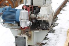 electrical mechanical actuator wheel gantry crane - stock photo