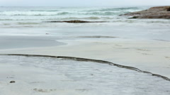 Small clear stream flowing into the sea (Norway, Lofoten). Stock Footage