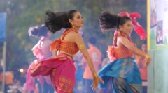 Students in traditional dress do a modern dance park,Ubon Ratchathani,Thailand Stock Footage
