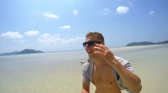 Young Handsome Man Walking on Tropical Beach. Slow Motion - stock footage