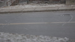 Snow falling against a road - stock footage