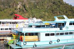 pleasure yacht for tourists on the island of Phi Phi - stock photo