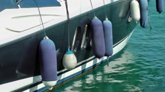 boat fenders side protectors blue bobbing movement - stock footage