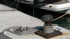 Boat mooring rope knot rusty bollard bobbing movement Stock Footage