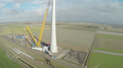 Aerial shot of a Windmill along the coast of the Netherlands Stock Footage