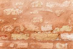 Texture Of Ancient Brick Wall In Close Up. Stock Photos
